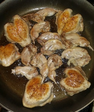 searing quail breasts and drumsticks